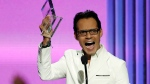 Marc Anthony reacts after winning the Tour of the Year award during the Latin Billboard Awards Thursday, April 30, 2015, in Coral Gables, Fla. (AP / Lynne Sladky).