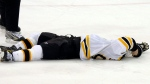 Boston Bruins' Marc Savard lies on the ice after being hit by by Pittsburgh forward Matt Cooke in the third period of an NHL hockey game against the Pittsburgh Penguins in Pittsburgh, Sunday, March 7, 2010. (AP / Keith Srakocic)