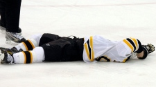 Boston Bruins' Marc Savard lies on the ice.