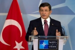 Turkish Prime Minister Ahmet Davutoglu speaks during a media conference at NATO headquarters in Brussels on Monday, Nov. 30, 2015. NATO Secretary General Jens Stoltenberg met with the Turkish prime minister on Monday to discuss the issue of a Russian warplane downed by a Turkish fighter jet at the border with Syria. (AP / Virginia Mayo)