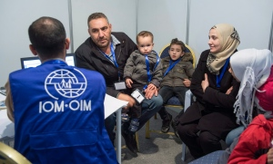 A family of Syrian refugees are being interviewed by authorities in hope of being approved for passage to Canada at a refugee processing centre in Amman, Jordan, on Sunday, Nov. 29, 2015. (Paul Chiasson / THE CANADIAN PRESS)