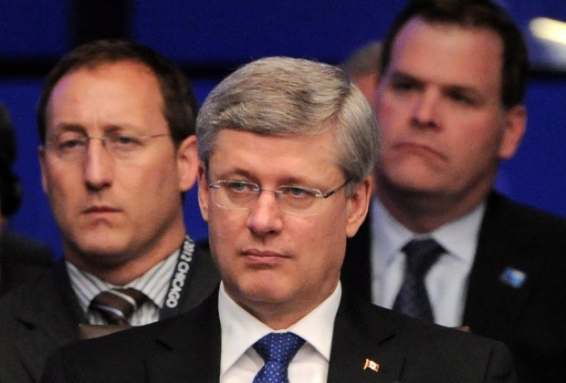 Prime Minister Stephen Harper, middle, sits in front of Minister of Defence Peter MacKay, left, and Minster of Foreign Affairs John Baird as they take part in a meeting on Afghanistan during the NATO Summit in Chicago, Ill., on May 21, 2012. (Sean Kilpatrick / The Canadian Press)