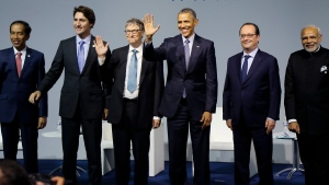 From the left, President of Indonesia Joko Widodo, Canadian Prime Minister Justin Trudeau, Microsoft CEO Bill Gates, US President Barack Obama, French President Francois Hollande and Indian Prime Minister Narendra Modi attend the 'Mission Innovation: Accelerating the Clean Energy Revolution' meeting at the COP2, United Nations Climate Change Conference, in Le Bourget, north of Paris, Monday, Nov. 30 2015. (Ian Langsdon, Pool photo via AP)