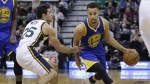 Golden State Warriors guard Stephen Curry drives around Utah Jazz guard Raul Neto in the first quarter during an NBA basketball game in Salt Lake City on Monday, Nov. 30, 2015. (AP / Rick Bowmer)