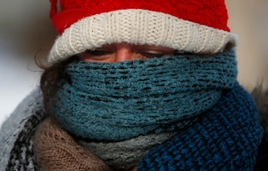 Betsy Ranum bundled up while walking down the street in Minneapolis in this file photo from Jan. 4, 2015. (AP/The Star Tribune, Richard Tsong-Taatarii)