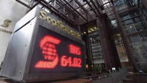 In this file photo, an electronic sign posting financial data is shown outside the Scotiabank building in Toronto Thursday, April 9, 2015. (Frank Gunn/THE CANADIAN PRESS)