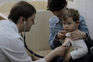 In this file photo, a doctor examines a child at Children's Hospital No. 1 in Kiev, Ukraine, on Apr. 23, 2013. (AP / Sergei Chuzavkov)