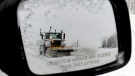 A snow plow is reflected in a sideview car mirror on Highway 401. (J.P. Moczulski/THE CANADIAN PRESS)