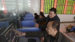Chinese investors check stock prices on computer terminals at a brokerage house in Fuyang in central China's Anhui province on Friday, Nov. 27, 2015. (Chinatopix)