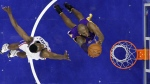 Los Angeles Lakers' Kobe Bryant, centre, goes up for a shot against Philadelphia 76ers' Jerami Grant during the second half of an NBA basketball game in Philadelphia on Tuesday, Dec. 1, 2015. (AP / Matt Slocum)