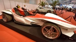 The Sbarro Triple car is shown at the Motor Show in the city of Essen, Germany, Wednesday, Dec. 2, 2015. The car by Italian designer Franco Sbarro has 3 seats and an engine with 400 horse powers. (AP / Martin Meissner)