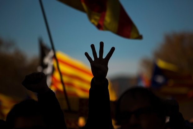 Pro-independence demonstrator with Catalonian flag