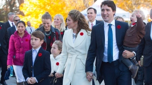 Marilou Trayvilla, one of two women employed to take care of the Trudeau children, is seen at left as she joins prime minister-designate Justin Trudeau and family in Ottawa on Nov. 4, 2015. (Sean Kilpatrick / THE CANADIAN PRESS)