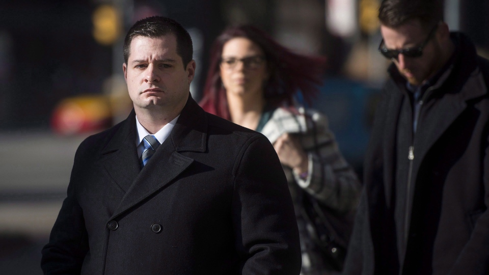Const. James Forcillo, charged in the shooting death of Sammy Yatim, walks into court in Toronto, Wednesday, Nov, 25, 2015. (Marta Iwanek / THE CANADIAN PRESS)