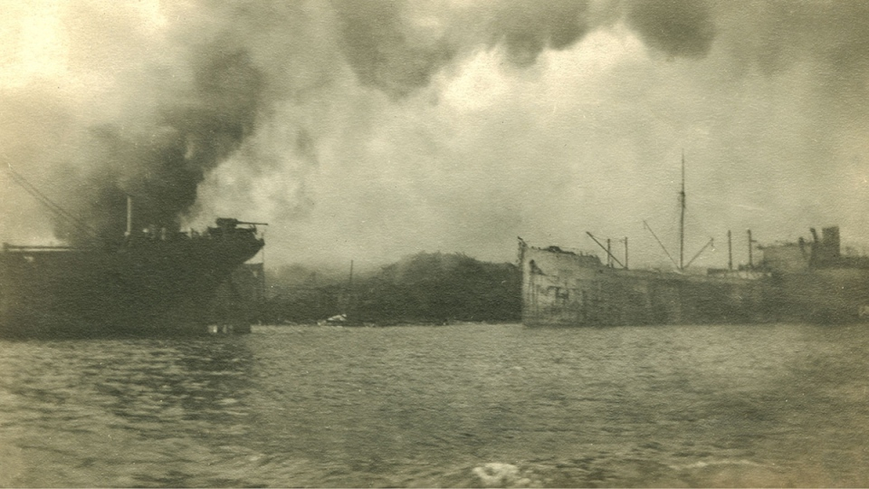 This archival photo shows ships in the Halifax Harbour after an explosion on Dec. 6, 1917. (Nova Scotia Archives / James Burn Russell)