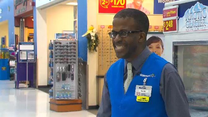 Wal-Mart greeter David Francis meets customers in Brampton.