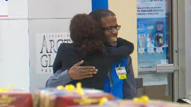 Wal-Mart greeter David Francis hugs a customer in Brampton.
