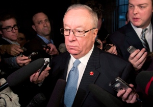 Senator Jacques Demers is shown speaking to media following a caucus meeting on Parliament Hill Tuesday, May 21, 2013 in Ottawa. (THE CANADIAN PRESS/Adrian Wyld)