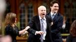 Newly-elected Speaker of the House Geoff Regan, centre, jokingly resists as he's escorted to the speaker's chair by Conservative interim leader Rona Ambrose, left, and Prime Minister Justin Trudeau in the House of Commons on Parliament Hill in Ottawa on Thursday, Dec. 3, 2015. (THE CANADIAN PRESS / Sean Kilpatrick)