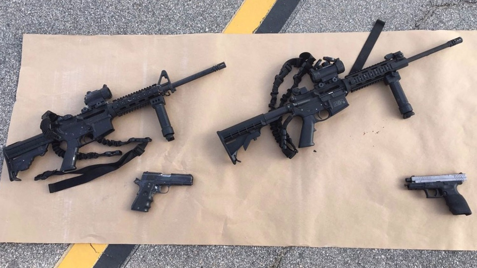 This photo provided by the San Bernardino County Sheriff's Department shows weapons carried by suspects at the scene of a shootout in San Bernardino, Calif. (San Bernardino County Sheriff's Department via AP)