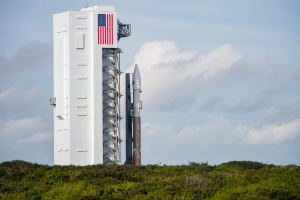 In this image released by NASA, an unmanned Atlas V rocket rolls out of the vertical integration facility to the launch pad, Wednesday, Dec. 2, 2015, at Cape Canaveral, Fla. The rocket due to lift off early Thursday evening with 7,400 pounds of supplies for the International Space Station. (Aubrey Gemignani/NASA via AP)