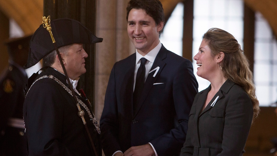 Prime Minister Justin Trudeau and Sophie Gregoire-Trudeau speaks with the Usher of the Black Rod Greg Peters as they wait for the arrival of the Governor General David Johnston for the speech from the throne in the Senate Chamber on Parliament Hill in Ottawa, Friday, Dec. 4, 2015. (Fred Chartrand / THE CANADIAN PRESS)