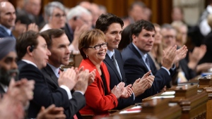 Prime Minister Justin Trudeau sits with members of his cabinet as they listen to the candidates vying for Speaker of the House of Commons deliver speeches prior to voting in the House of Commons on Parliament Hill in Ottawa on Thursday, Dec. 3, 2015. (THE CANADIAN PRESS / Sean Kilpatrick)