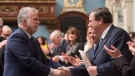Quebec Premier Philippe Couillard, left, congratulates then-Education Minister Francois Blais after he tabled legislation on school boards, Friday, December 4, 2015 at the legislature in Quebec City. THE CANADIAN PRESS/Jacques Boissinot