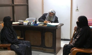 In this photo released on Feb. 10, 2015 by a militant website, which has been verified and is consistent with other AP reporting, women sit in the office of an Islamic State group judge in Raqqa City, Syria. (Militant website via AP)