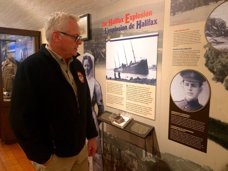 Ken Hynes, curator of the Army Museum at Citadel Hill, looks at a photo of his grandfather, Fletcher Manchester Bartlett, who was working at Citadel Hill at the time of the Halifax Explosion on Dec. 6, 1917. (Aly Thomson / THE CANADIAN PRESS)