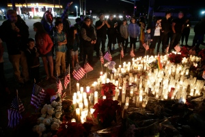 People pay respects at a makeshift memorial site honoring Wednesday's shooting victims, Sunday, Dec. 6, 2015, in San Bernardino, Calif. (Jae C. Hong / AP Photo)