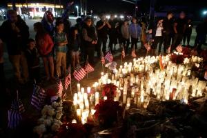 People pay respects at a makeshift memorial site honoring Wednesday's shooting victims, Sunday, Dec. 6, 2015, in San Bernardino, Calif. (Jae C. Hong / AP Photo)