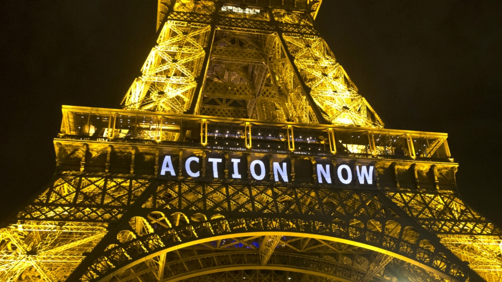 Eiffel Tower lights up for climate talks