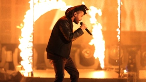 In this Sunday, Nov. 22, 2015 file photo, The Weeknd performs at the American Music Awards at the Microsoft Theater in Los Angeles. (Photo by Matt Sayles/Invision/AP)