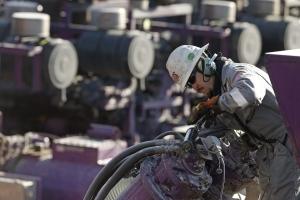 In this March 25, 2014 file photo, an Encana worker oils a pump near Mead, Colo. (AP/Brennan Linsley)