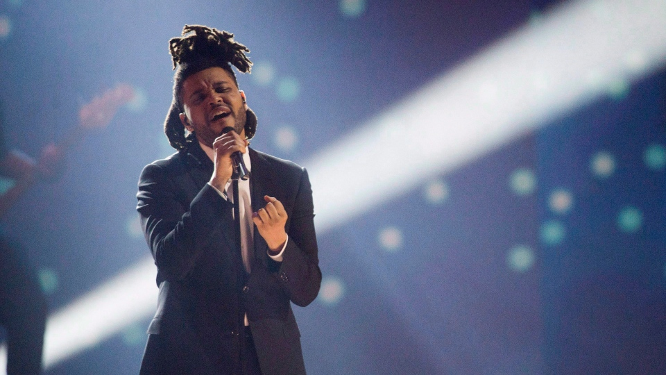 The Weeknd performs during the 2015 Juno Awards, in Hamilton, Ont., on March 15, 2015. (Nathan Denette / THE CANADIAN PRESS)