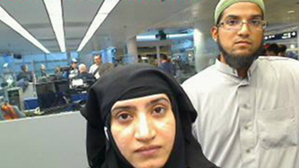 This photo provided by U.S. Customs and Border Protection shows Tashfeen Malik, left, and Syed Farook, as they passed through O'Hare International Airport in Chicago on July 27, 2014.