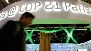 A man walks past the Indian Pavilion at the COP21, the United Nations Climate Change Conference, in Le Bourget, north of Paris on Monday, Dec. 7, 2015. (AP / Christophe Ena)