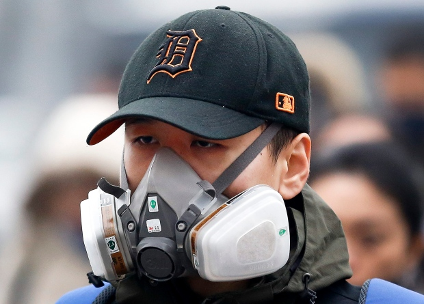 Mask in Beijing (AP/Andy Wong)