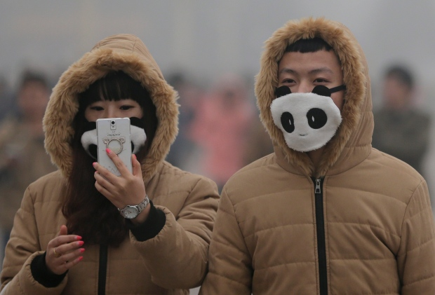 Couple wearing masks in Beijing (AP/Andy Wong)
