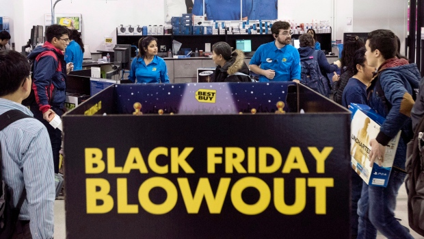 Customers wait in line to purchase electronics at a Best Buy store during Black Friday sales in Toronto on Friday, Nov. 27, 2015. (THE CANADIAN PRESS/Darren Calabrese)
