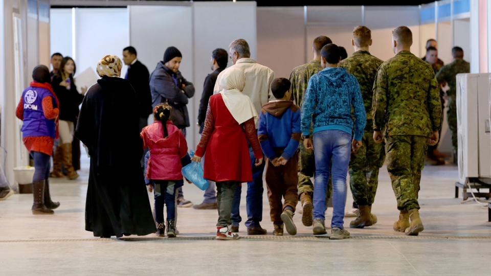 Canada-bound Syrian refugees wait at Marka Airport in Amman, Jordan, on Dec. 8, 2015. (Raad Adayleh / AP)