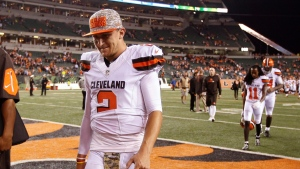 Cleveland Browns quarterback Johnny Manziel walks off the field after the Browns lost 31-10 to the Cincinnati Bengals during an NFL football game Thursday, Nov. 5, 2015, in Cincinnati. (AP Photo/Frank Victores)