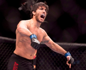 In this file photo, Elias (The Spartan) Theodorou celebrates his win over Sheldon Wescott at the UFC Fight Night in Quebec City, Wednesday, April 16, 2014. (Jacques Boissinot/THE CANADIAN PRESS)