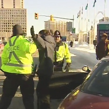 Ottawa police speak to one angry commuter who used aggressive behaviour at the picket line at Ottawa City Hall, Thursday, Dec. 11, 2008.