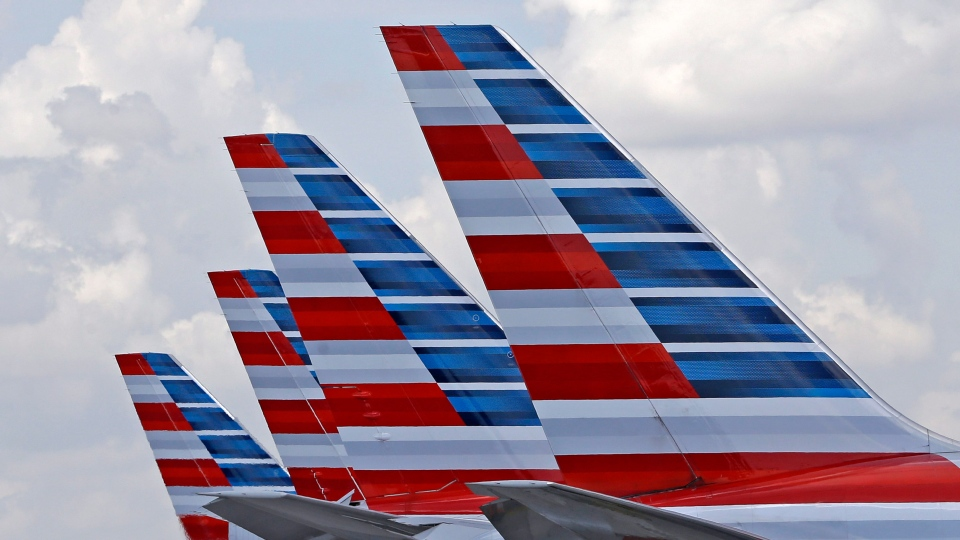 The tails of four American Airlines passenger planes are shown parked at Miami International Airport, in Miami on July 17, 2015.  (AP /Alan Diaz)