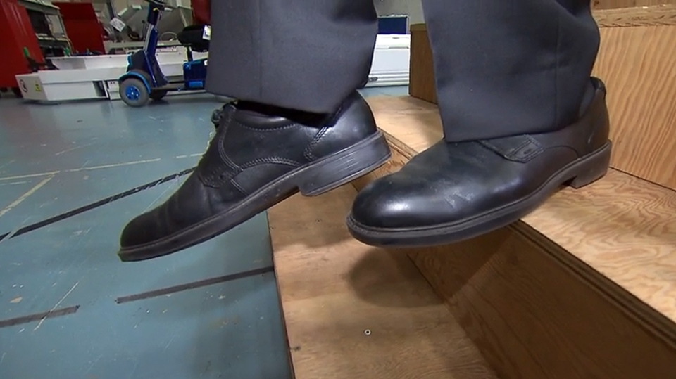 Dr. Geoff Fernie, research institute director and the Toronto Rehab Foundation, demonstrates how easily a person could lose their footing on steps with a standard minimum 21-centimetre (or 8.25 inch) depth.