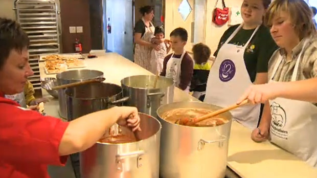 Students from Beiseker Public School learn to make soup with volunteers from Soup Sisters, a charitable endeavour started by Sharon Hapton in 2009