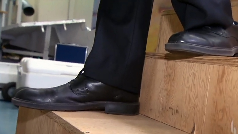 Dr. Geoff Fernie demonstrates a more secure footing on a step with a tread of 25 centimetres (10 inches)