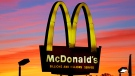 The sun sets behind a McDonald's in Ebensburg, Pa. on Saturday, Oct. 10, 2015. (AP / Gene J. Puskar)